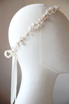 A bespoke pearl and crystal headband for Bonnie I would love some simple pearl tiara to hold down the veil.