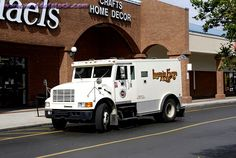 Armored Bank Trucks | Armored Truck Picks Up And Delivers Cash Money To Banks And Businesses
