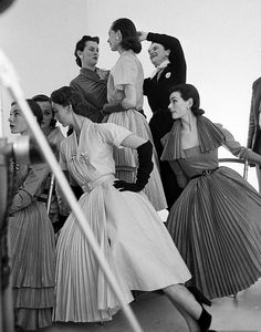 1951, Bettina, Sophie and Anne Gunning are being prepared for a photo shoot with John  Rawlings for Vogue.