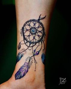 If color is what you are looking for then this is one of those dream catcher tattoo ideas that will definitely appeal to you. The tattoo manages to be very vivid and colorful without appearing too distracting. It does this by using rich colors such as emerald blue and purple. #tattoofriday #tattoos #tattooart #tattoodesign #tattooidea