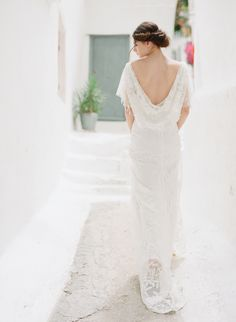 Cowl back lace wedding dress: http://www.stylemepretty.com/destination-weddings/2015/11/07/ethereal-grecian-bridal-portrait-inspiration-in-athens/ | Photography: Vasia - http://www.vasia-weddings.com/