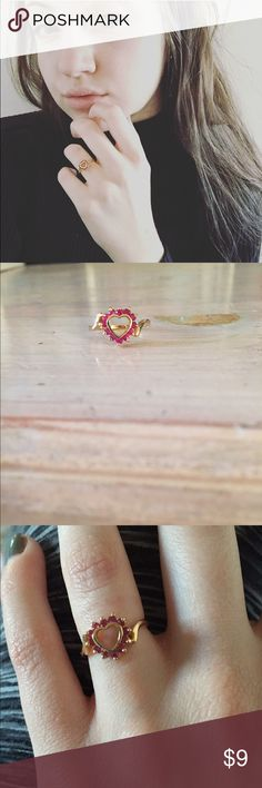 ❤️ Valentine's Day heart ring ❤️ This is an absolutely perfect Valentine's Day gift for anybody wife, girlfriend, sister, daughter anybody! It has a gold colored band with gems in the same of a heart. NOT REAL GOLD NOT REAL STONES. Not free people just for exposure. Item is unbranded. Free People Jewelry Rings