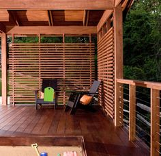 Deck wall. Horizontal slats, darker stain.