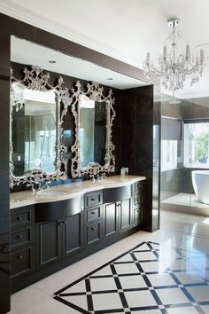 LOVE this bathroom. Especially the elegant mirrors