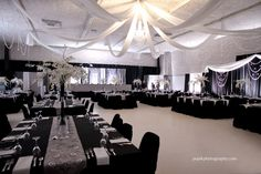 Wedding Decor by Dar's Decorating - with grey and silver damasks, black and white silks, crystal chandeliers, and orchid centerpieces