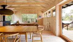 Inside the Holiday House Vindö by Stromma Projekt with the CH24 Wishbone Chairs http://www.nest.co.uk/search/carl-hansen-ch24-wishbone-chair Image via Dezeen.