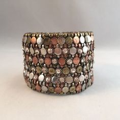 "6 rows of alternating copper, brass, silvertone and rhinestone embedded round metal links stretch Bracelet. Top and bottom edged with brass round metal beads.  Measures 1 13/16"" wide.  Pre-owned. Excellent condition.  Free shipping. Ships within 3 business days within the US only via USPS First Class mail."
