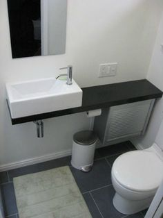 A tiny bathroom is possible with the right fixtures. Turn a closet into a hall bath! Sink found at Ikea. Bathroom Bath Vanity from Appliance Cabinet - IKEA Hackers Ikea Sinks, Small Bathroom Sinks, Small Sink, Small Toilet, Tiny Bathrooms, Ikea Bathroom, Tiny House Bathroom, Bathroom Hacks, Bathroom Ideas
