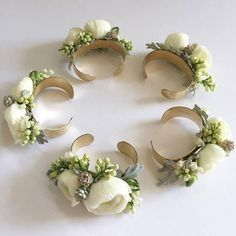 Garden roses, stock and dusty miller bridesmaid cuff corsages.                                                                                                                                                                                 More