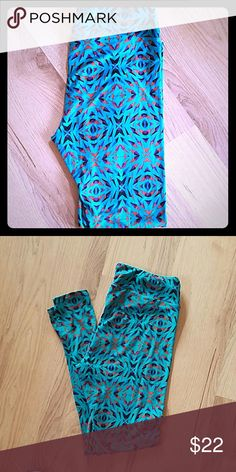Lularoe TC leggings Lularoe TC patterned leggings. Background is teal with fun design of colors orange, black, purple and blue. Great for spring and summer! Worn once. Washed once inside out and hung to dry. These are so buttery soft! LuLaRoe Pants Leggings
