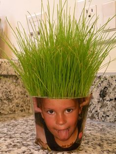 Summer : take a picture of child(cut off their hair from the picture) plant grass