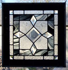 I absolutely love this black and clear stained glass window with diamond bevels!