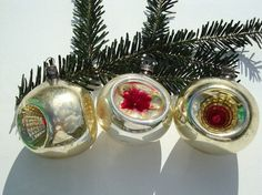 Glass Christmas indent ornaments are vintage Christmas tree decorations. Mercury glass balls are deep indented glass ornaments for Christmas vintage style or retro decor. Youll get a set of three glass balls, two triple indented and one indented. These Christmas ornaments are vintage collectible items and nice gift for collectors. Balls have some missing paint and discolored spots because of its age. Use zoom button to see it better. Measurements are: -diameter 6,5 cm = 2,6 inches and 6 ...
