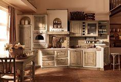 Cucine Zappalorto  Paolina gianduia, con un effetto muro panna frattonato e piano Piriti multicolor in ceramica