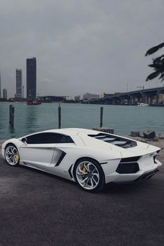 The Lamborghini Huracan was debuted at the 2014 Geneva Motor Show and went into production in the same year. The car Lamborghini's replacement to the Gallardo. The Huracan is available as a coupe and a spyder. Lamborghini Aventador, Carros Lamborghini, Lamborghini Photos, Ferrari 458, Custom Lamborghini, White Lamborghini, Maserati, Luxury Sports Cars, Dream Cars