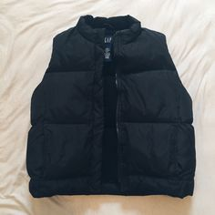 Gap Puffer Vest Worn a couple times, but still in great condition! Has pockets on both sides.  Looking to sell, but there are a few things I'd be willing to trade for. (See my ISO List at the top of my closet)  If you have any questions, feel free to ask!  GAP Jackets & Coats Vests