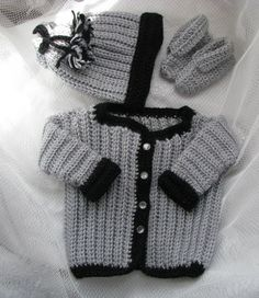 Soft 4 pc sparkly silver with sparkly black trim Baby Sweater Set with Cap and Booties fits 0 to 6 months old.  This 4 piece set is crocheted with soft sparkly silver and black yarn of the same brand yarn and soft to the touch. This set is washable. The above item is ready to ship within 3-5 days. Please see my policies regarding custom made products.  Please contact me if you are making more than one purchase as I will have to adjust the shipping on the invoices accordingly before you…