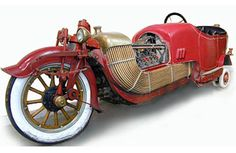 """Beautiful 1913 Scripps-Booth Bi-Autogo. A 3,200-lb. motorcycle with training wheels that lower at slow speeds for stability, a V8 engine and enough copper tubing to provide every hillbilly in the Ozarks with a still. The Bi-Autogo does enjoy the historical distinction of being the first V8-powered vehicle ever built in Detroit."" via BoingBoing"