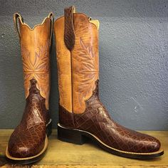 """Handmade Cowboy boot with 13"""" Horween natural uppers, Oak stitching in blue and red, round toe, double scallop, and cigar alligator flank vamps."""
