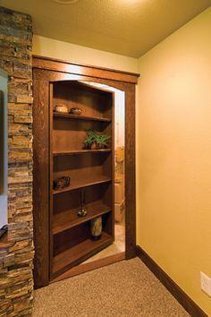 Basement Hidden Storage The bookcase is a secret door that hides storage. ©Finished Basement Company