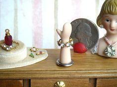 "1:12 Scale Dollhouse Miniature Bracelet Display Stand, ""Diamond"" Rhinestone & gold cuff bracelet, Porcelain jewelry mannequin stand room box by larkinbirdvintage on Etsy"