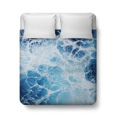 A vivid beach ocean bedding accent for your surf bedroom interiors, this  duvet cover bed blanket throw features a deep blue sea of coastal waves  throughout! Available in Twin, Full, Queen and King size, this beach  bohemian chic bedroom throw makes for a vibrant addition to any coastal  home themed settings!   *Available in Twin, Full, Queen or King Size