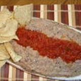 This is a great-tasting dip served with tortilla chips and raw veggies for dipping. Itmay be served hot, warm, or at room temperature. May be made several days ahead, and even frozen if desired (texture will suffer a bit from freezing and defrosting, but not much). Kitchen Tool Tip: The bean dip may be pureed in a food processor, blender, or with an immersion blender. For information on an immersion blender, see Creole White Bean Dip.