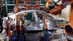 INGOLSTADT, GERMANY - MARCH 08: Robots braze the car body of an Audi A5 at the production line on March 8, 2010 in Ingolstadt, Germany. Audi AG is a unit of Volkswagen AG. (Photo by Miguel Villagran/Getty Images)