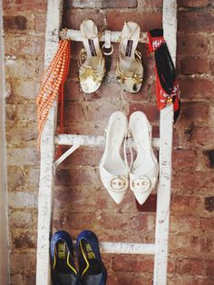 Use an old ladder to hang heeled shoes on.