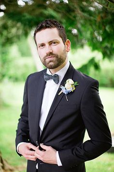 Dapper navy suit and bowtie groom style | onefabday.com