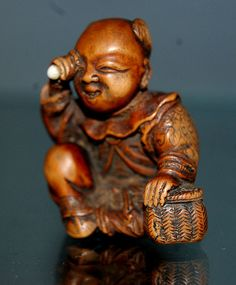 Man inspecting Egg Netsuke by Curious Expeditions, via Flickr