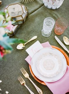 Glass and other cutlery, dishes and decor in varied jewel tones are perfect for this bohemian style wedding
