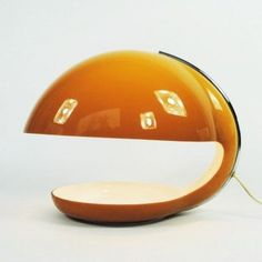 Located using retrostart.com > Desk Lamp by Harvey Guzzini for Guzzini