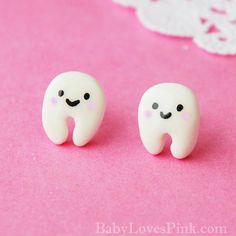 tooth earrings.  happy little teeth.