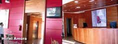 Paneles y revestimiento en madera en el Hotel Amura