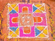 Colourful rangoli made during traditional wedding ceremony in India.