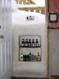 Not a fan of snow....but this sorta makes me jealous of the blizzard.  I want a snow beer fridge! Too funny!