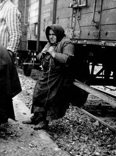 Birkenau, Poland, Babo Batren from Tacovo, Hungary leaning on a train car, May 1944.