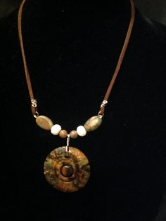 A viking inspired necklace,carved stone pendant,carved bone beads and jasper on a leather cord. Www.the-violet-rose.com