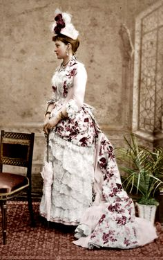 This is how a young Lady of means was supposed to look when going out during the day in the second bustle period with a feathered hat, long train, abundant lace, layers of skirts, jewelry, and parasol. | Ella of Russia wearing bustle dress From wikidi.com:view:alexandra-fyodorovna-of-hesse