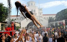 On the feast of John the Baptist in the Philippines, people soak each with water in remembrance of Jesus' baptism. Here a soaked gymnast is tossed in the air.