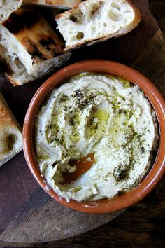 Earlier this summer I met up with some friends in NYC for a potluck, which, oops, I showed up empty-handed to. Everything, of course, was delicious, but after the homemade pita, hands down the most popular item on the table was a dip, whose pallid, unassuming complexion, I think, caught everyone off guard — this...