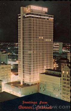 View of Security Life Building at Night Denver Colorado c. 1967 with neon lit name on top. Tallest building downtown at the time. Had a glass elevator on st side of building. Lakewood Colorado, Denver Colorado, Denver Tv, Glass Elevator, Vintage Neon Signs, Mountain High, Neon Lighting, Rocky Mountains, Around The Worlds