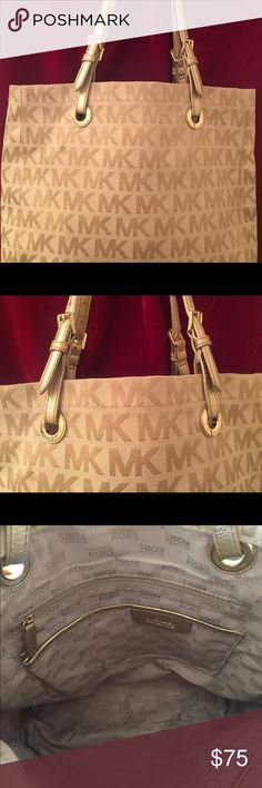 Authentic Michael Kors Large Canvas Tote Bag Fun authentic MK weekender Tote bag. Versatile color goes great with everything. I love this bag for work, fits all my essentials plus my lunch bag and iPad. Lightly used, good condition -- few small marks that can be cleaned. Why am I selling this? Because I am a purse/bag junkie and my deal with my husband is I can buy more if I sell some of what I have. Non-smoking, clean home. Michael Kors Bags Totes