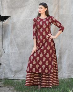 Shop online Maroon block printed kurta with striped palazzos Featuring eye-catching block prints all over the kurta, this maroon kurta set with the matching striped palazzos exudes unmatched panache with style and grace Simple Kurta Designs, Kurta Designs Women, Salwar Designs, Blouse Designs, Indian Attire, Indian Wear, Indian Dresses, Indian Outfits, Printed Kurti Designs