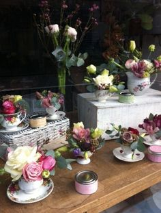 This year for Mother's Day, we decided to fill our window with some very pretty vintage tea cups filled with some equally pretty flowers A...