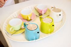 colourful teapots and teacups by I Want You To Know UK Fashion Blog, via Flickr