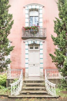 An adorable pink house in the Loire Valley in France.