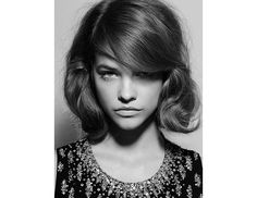 @Byrdie Beauty - Use long side bangs to conceal a faux-bob.