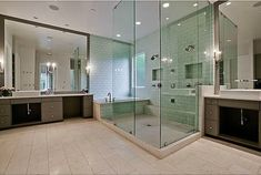 Bath in shower enclosure with double showerheads | Hooked on Houses - modern home of a Swedish NHL player